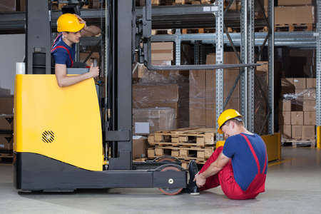 accident at work: Horizontal view of a forklift accident in storehouse Stock Photo