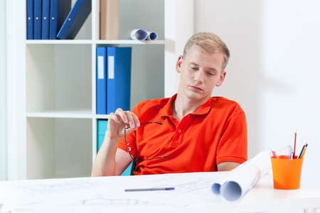 Horizontal view of tired architect during work photo