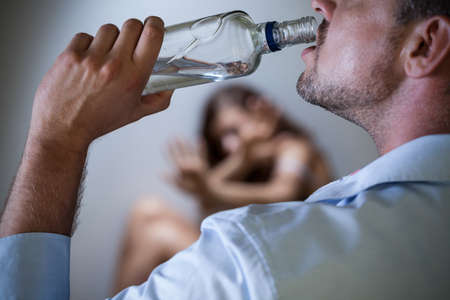 View of violent husband with alcoholic problem photo
