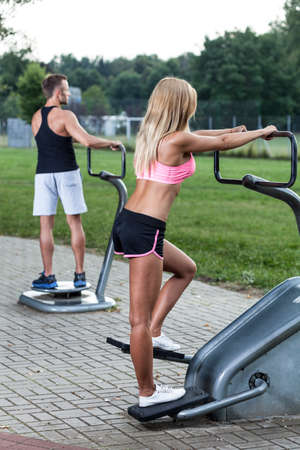 mutual: Mutual training on the outdoor gym, vertical Stock Photo