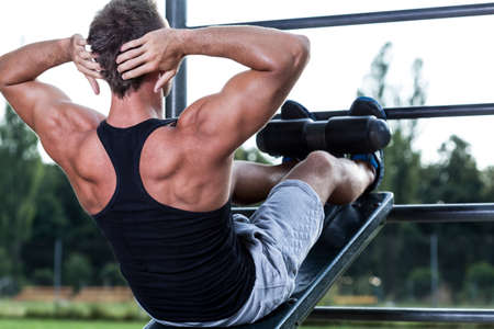 jungle gym: Man training on the outdoor gym, horizontal Stock Photo