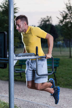 jungle gym: Athletic man during training on the outdoor gym