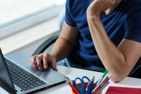 Horizontal view of man working on laptop
