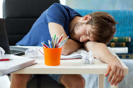 tiredness: Student sleeps on the desk after learning