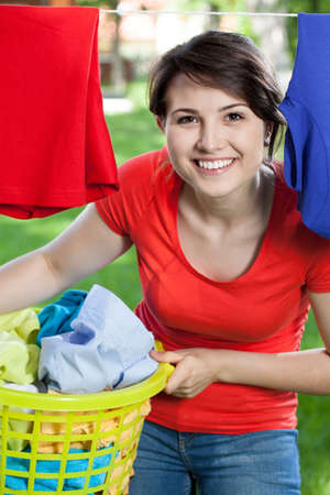 Portrait of a happy woman doing housework outside photo