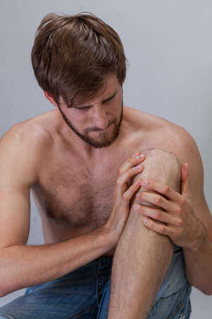 throe: Vertical view of man with hurting knee