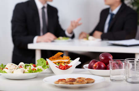 lunch meeting: Close-up of a food and men during lunch break Stock Photo