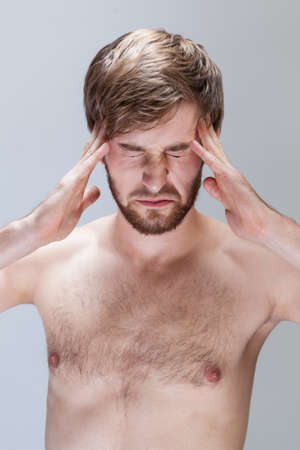 throe: Vertical view of man suffering from headache
