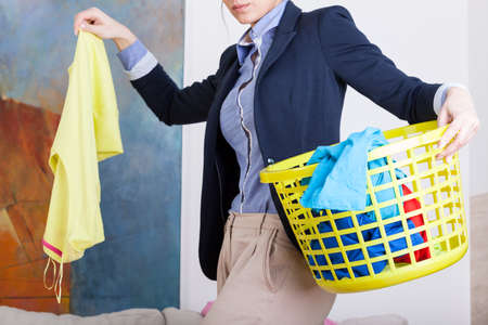 laundry room: Businesswoman collecting dirty clothes before going to work