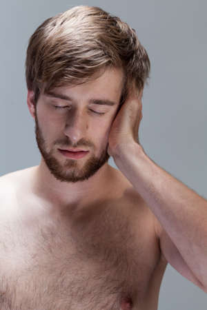 throe: View of tired man suffering from headache Stock Photo