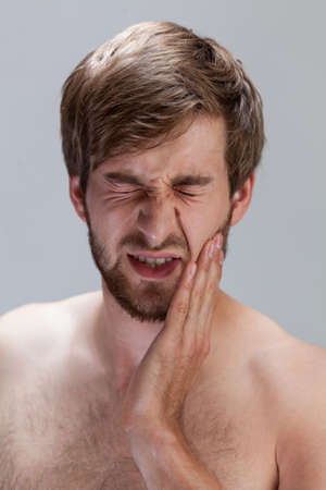 throe: Vertical view of man suffering from toothache