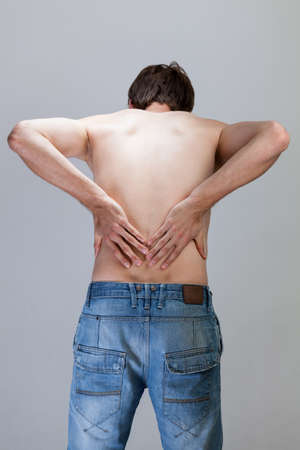 throe: Vertical view of a man feeling backache
