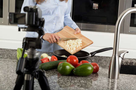 Woman leading a culinary program in television