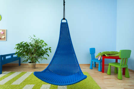 View of hanging chair in child room photo