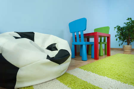 pouf: Horizontal view of table in kids room Stock Photo