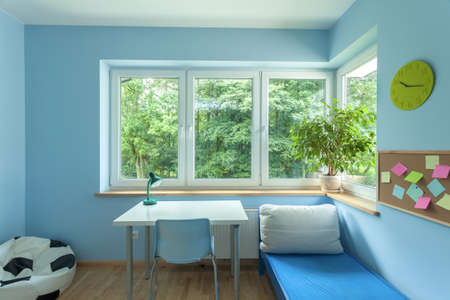 pouf: Horizontal view of the bright blue room