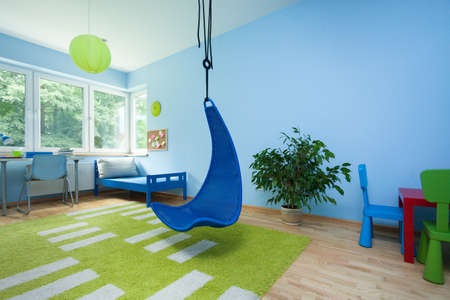Interior of child room with hanging chair photo