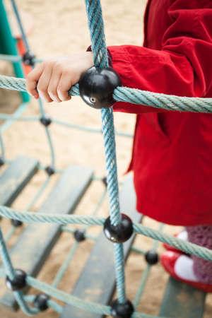 brisk: Little girl having fun on a playground Stock Photo