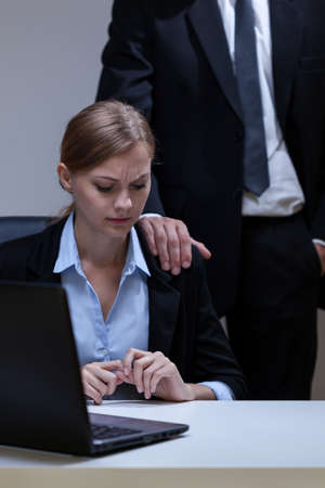 View of woman who doesn't like boss's touch Standard-Bild