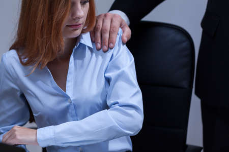 View of woman feeling uncomfortable at work