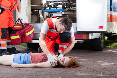 unconscious: Emergency service working on the street, horizontal Stock Photo