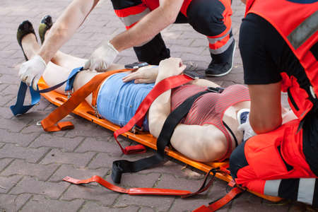 rescuer: Paramedics taking woman to the hospital Stock Photo