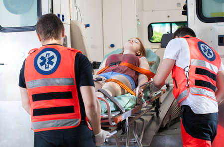 Woman after accident in ambulance, horizontal