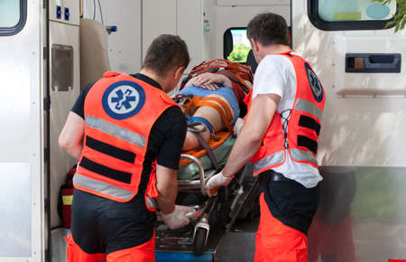 Woman after accident inside the ambulance, horizontal photo