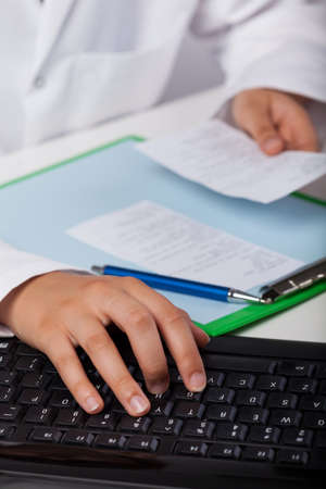 View of pharmacist using computer at work