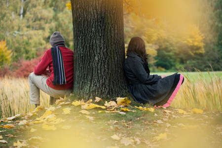 human relationship: Man and woman contemplationg in the autumn park Stock Photo