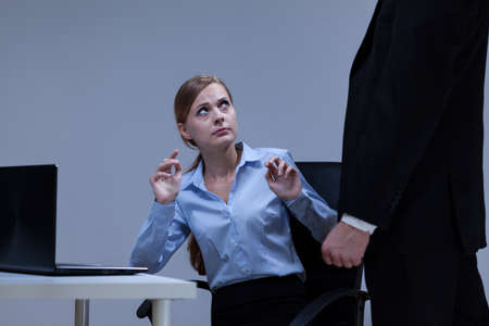 unprofessional: Woman is afraid of her boss in the office