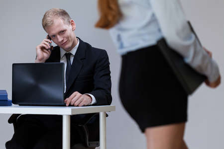 Male worker looking at sexy woman, horizontal photo
