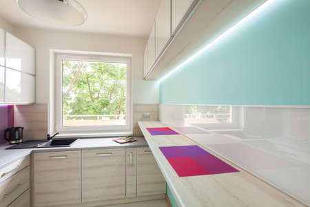 blue white kitchen: View of modern kitchen with neon lighting