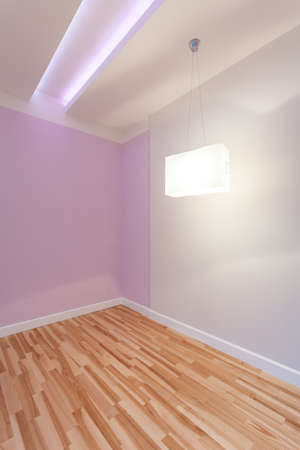 View of empty room with illuminated ceiling photo