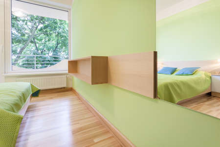 Horizontal view of bright and green bedroom photo