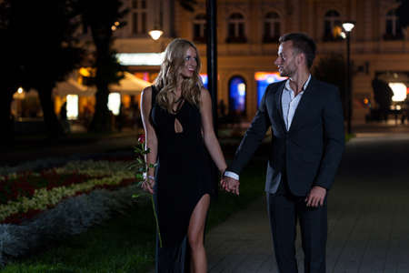 Sexy couple in the city at night photo