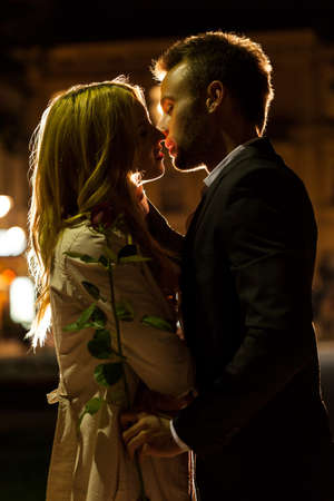 affectionate: Couple kissing on a date at night Stock Photo