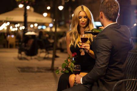 romantic sexy couple: Romantic night with wine in the city