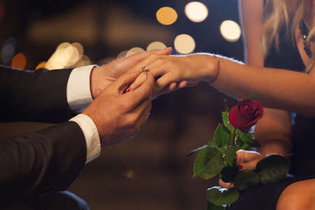 Close-up of romantic proposal in the city