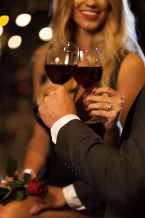 romantic evening with wine: Couple drinking wine after proposal in the city