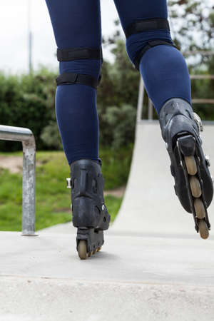 halfpipe: Girl riding rollerskates at a skate park