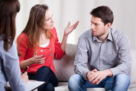 Young marriage are on psychotherapy session with problems photo
