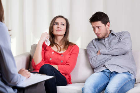 Young unhappy couple on special marriage therapy session Stock Photo