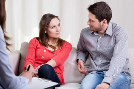 Happy young marriage starting new life after therapy session 스톡 콘텐츠