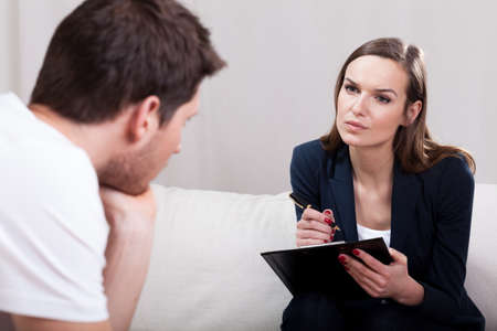 Professional experienced therapist conducting interview with patient
