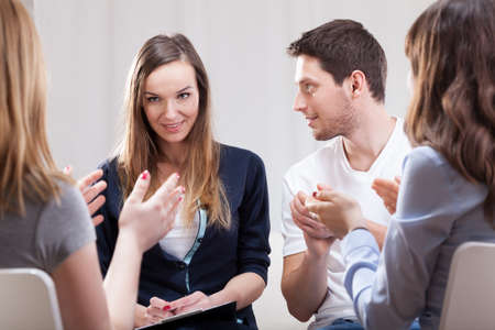 counselling: Young woman talking about her life on group therapy Stock Photo