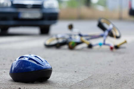 helmets: Close-up of a bicycle accident on the city street Stock Photo