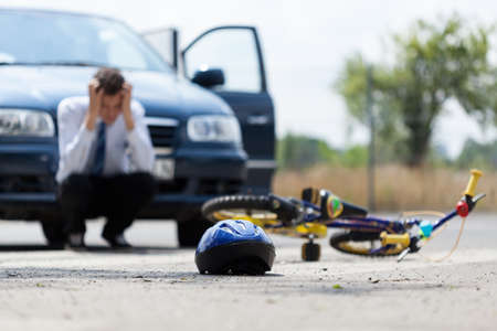 road bike: Sad driver after collision with bicycle, horizontal Stock Photo