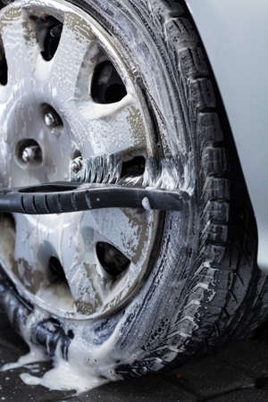 hubcap: Wheel cleaning on a car wash, vertical Stock Photo