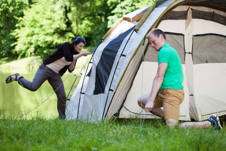Young Couple Trying To Pitch A Tent Stock Photo Picture And Royalty Free Image. Image 31240050. & Young Couple Trying To Pitch A Tent Stock Photo Picture And ...